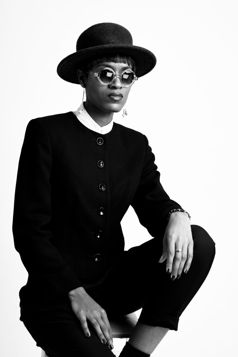 Donya Patrice from the style siblings posing in a suit and hat