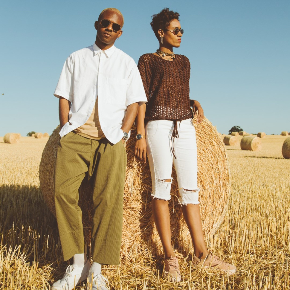 Style Siblings posing in a field