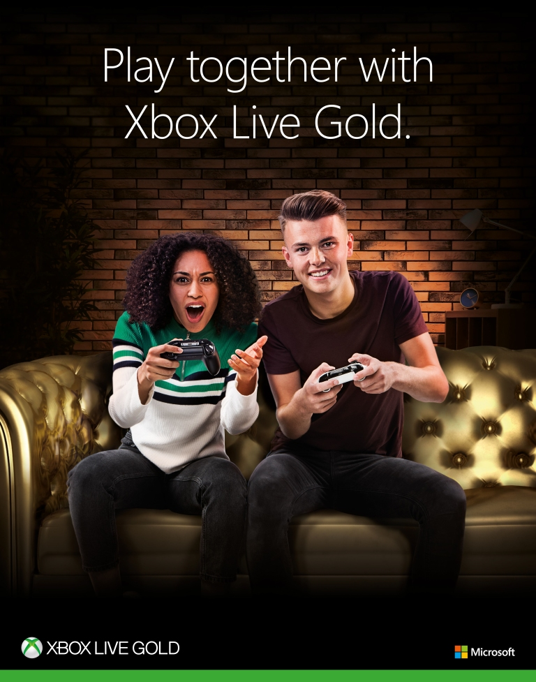 Annabella King and Joe Pemberton posing with an Xbox remote for Xbox Live Campaign with Sandra Reynolds